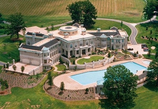Rick ross bought evander holyfield 39 s old mansion for Biggest house in usa
